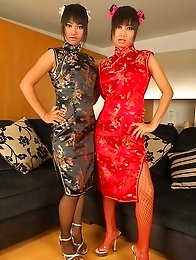 Oriental Lesbians with a big red toy