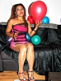 Here we have Mistress Ooy all surrounded by a fairy of colorful balloons and wearing a very sexy pink dress.