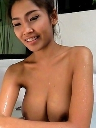 Amazing thai lady Tittiporn showing her giant boobs and pussy