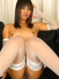 Thai Chick Kanda stripping off her negligee